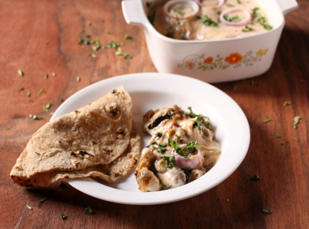 Baingan ki Borani or Borani Banjan is a vegetarian recipe comprising of fried eggplant in a spicy gravy, topped with yogurt, coriander and onions.