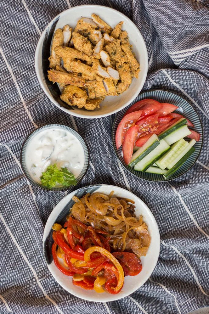 Healthy, delicious, home-made chicken shawarma recipe. Serve this Middle-Eastern dish in a wrap with caramelised onions & capsicum, lettuce, tomato and dollops of tzatziki sauce