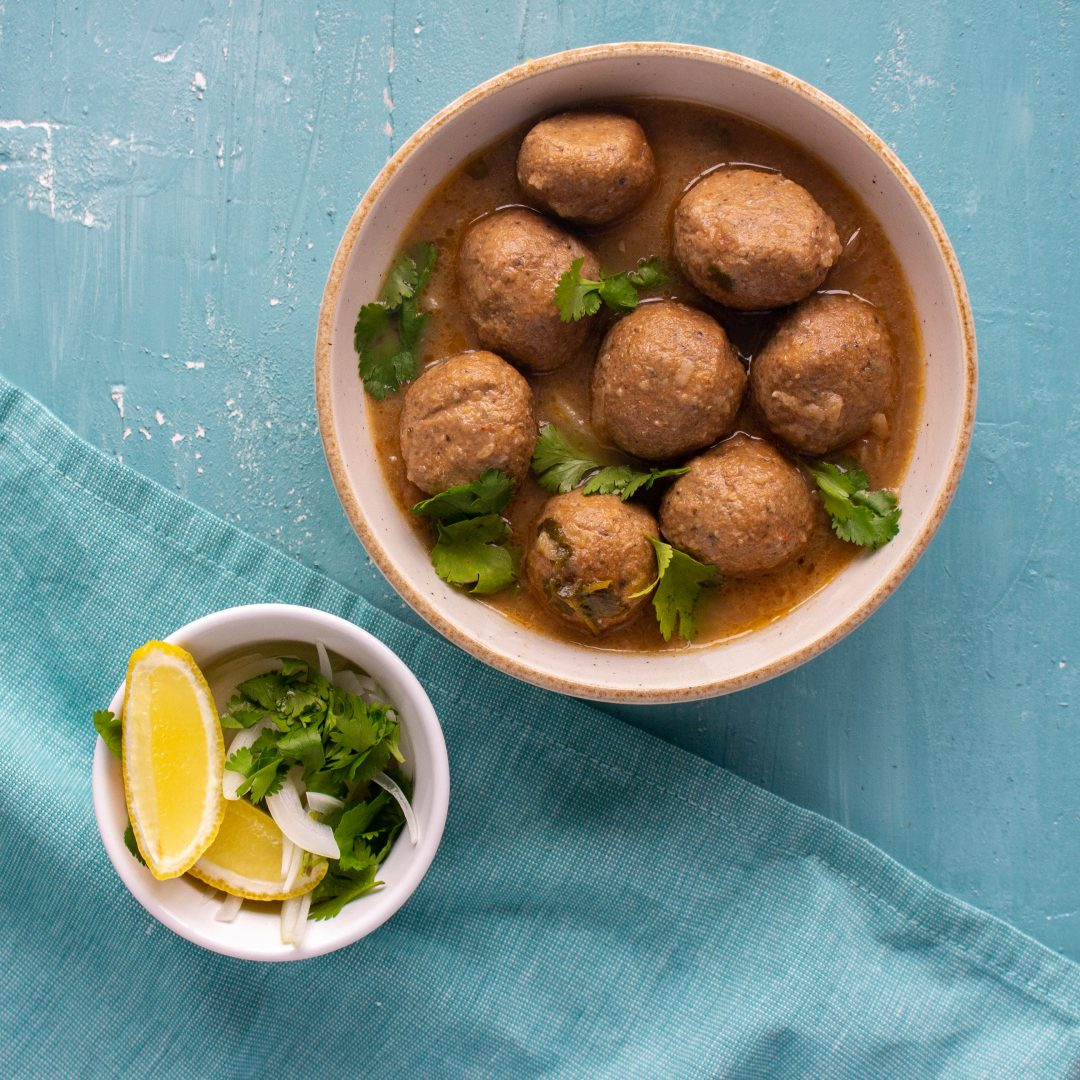 Chicken kofta curry or chicken koftay ka salan is a traditional Pakistani curry made of chicken meatballs that are simmered in an onion-based curry. Serve with pickled onions, and rice or roti.