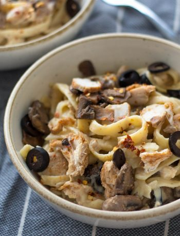 This white sauce pasta is all about indulgence. There's buttery garlic mushrooms, spicy grilled chicken and a cheesy white sauce that brings everything together!