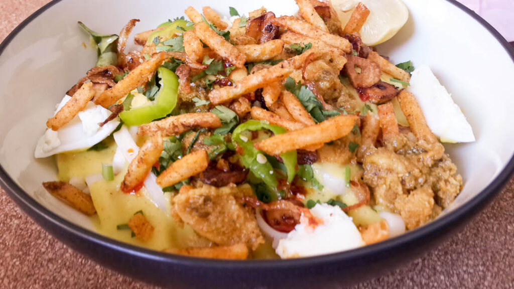 Originally from Burma, Khao-Suey is a popular dish among the Memon & Gujrati community of Pakistan. It comprises of noodles in a coconut or yoghurt based curry, with spicy chicken or beef and an array of condiments which will always include crisps or Slims and a squeeze of lemon juice.