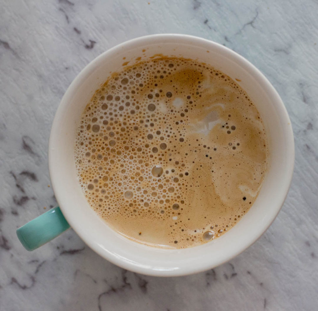 Homemade cappuccino, desi cappuccino or beaten coffee is made by whisking instant coffee, sugar and water till it creates a thick paste. This paste creates a creamy froth without using a fancy coffee machine.