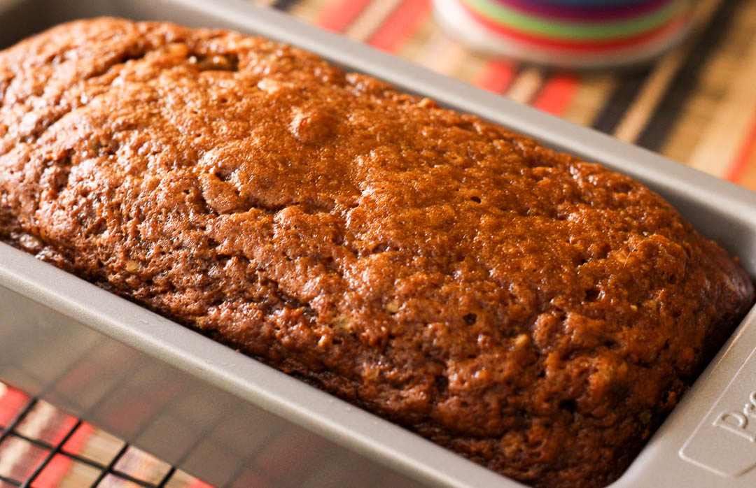 This delicious banana bread with a hint of cinnamon is a hybrid between a sweet cake and a hearty bread loaf. Make sure you use ripe banana's for the best flavor.
