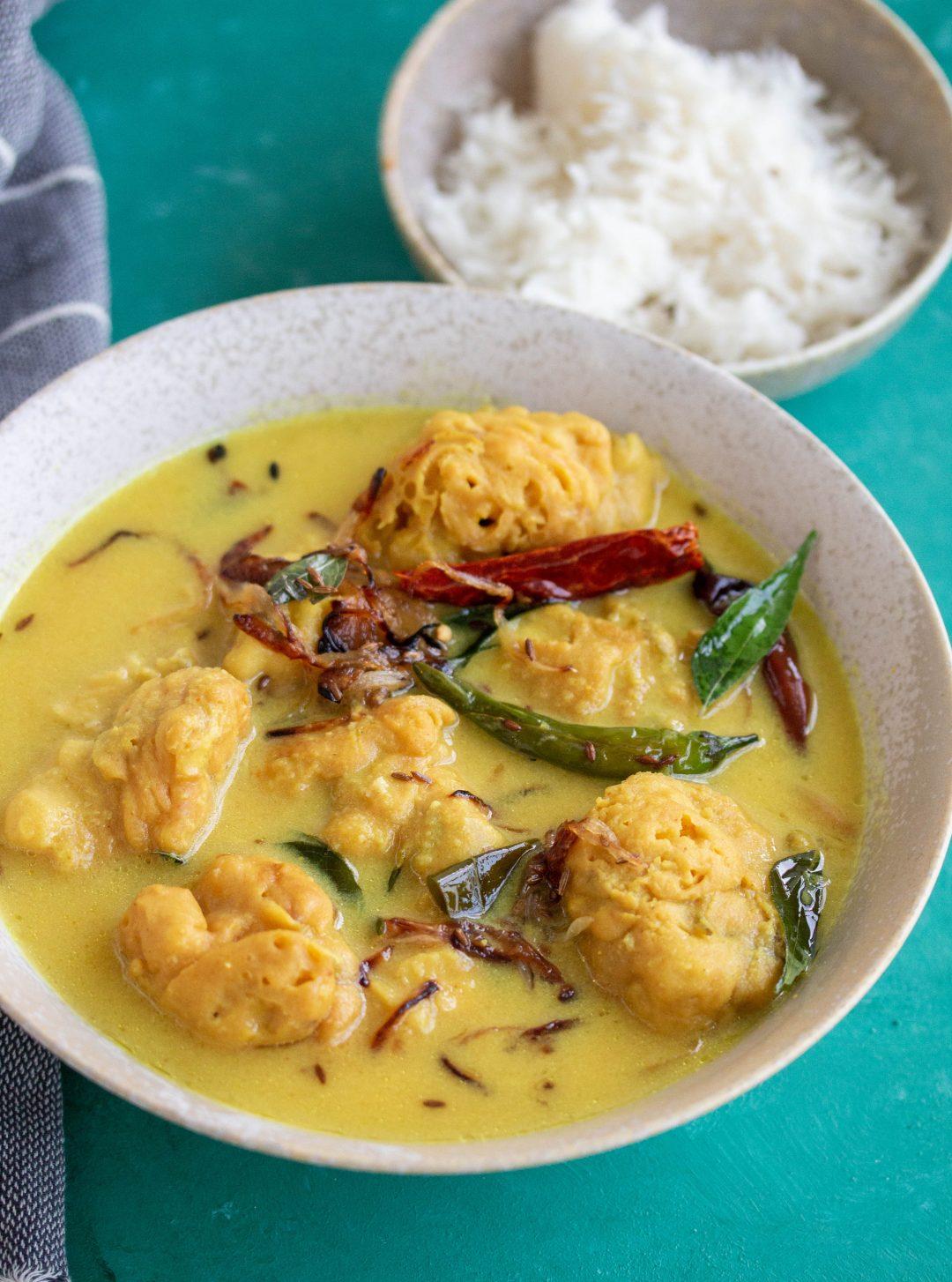 Karhi or Karhi Pakora is a Pakistani vegetarian dish consisting of a sour yoghurt & chickpea flour/besan base with pakora's or vegetable fritters.