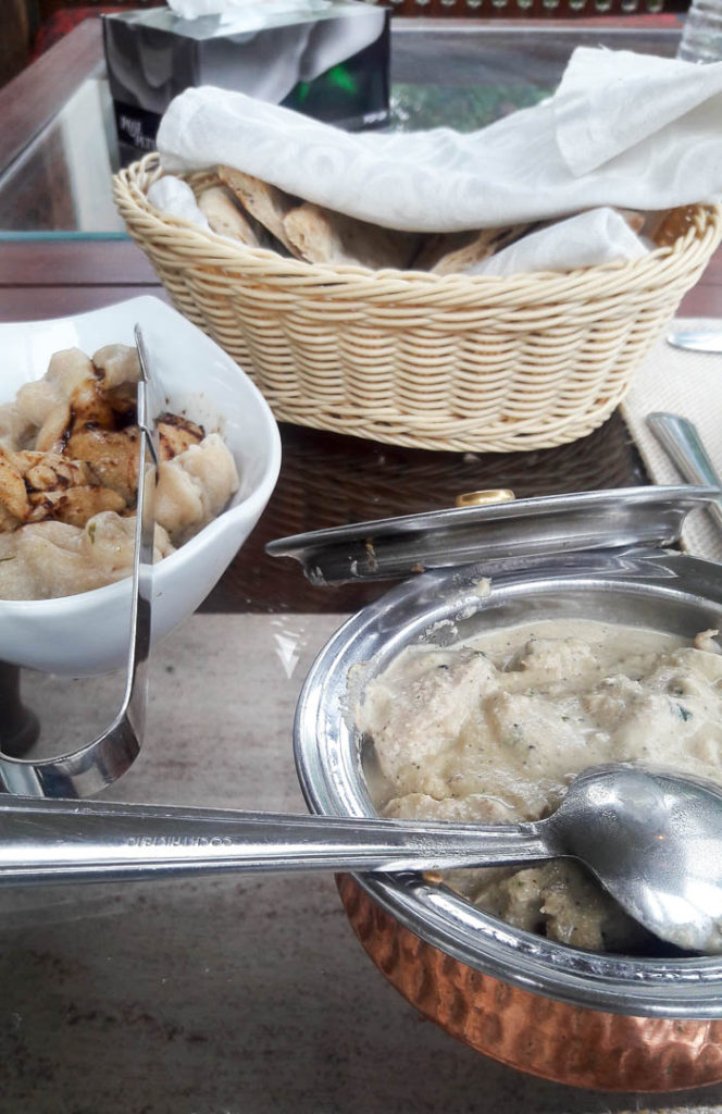 Enjoying a late lunch on our first day at Khaplu Palace in Gilgit. Chicken in a creamy walnut sauce with mamtu (meat dumplings) and garam naan.