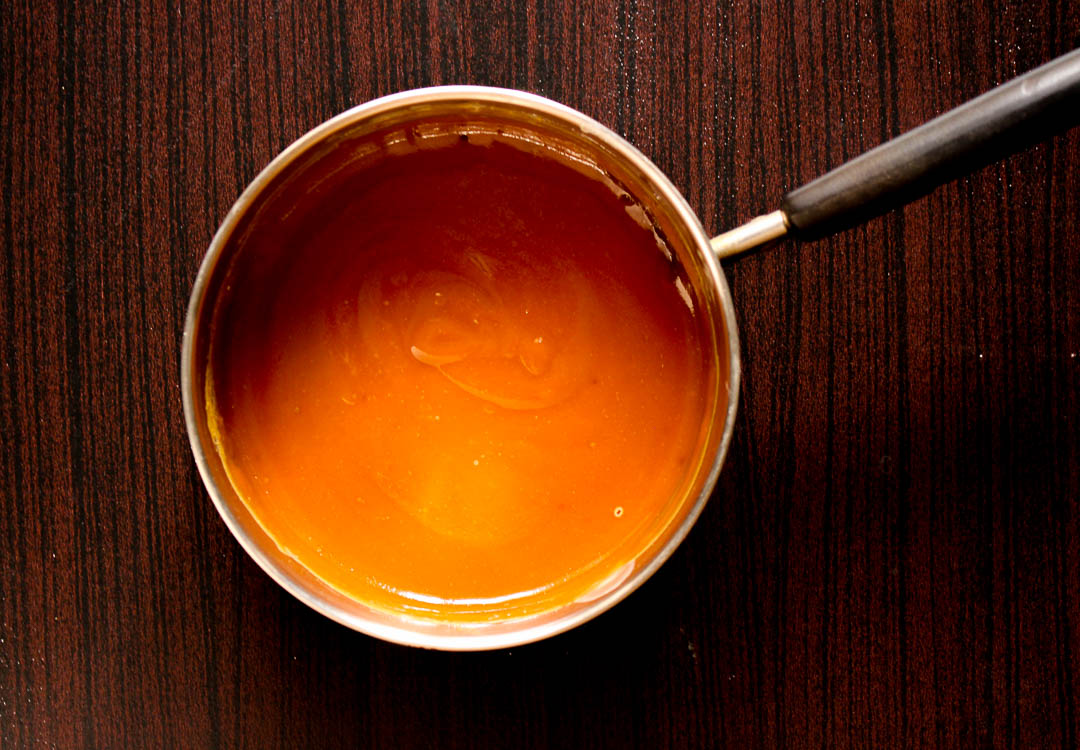 Follow these easy instructions to make salted caramel sauce at home. Keep a bottle in the fridge to add to your favorite dessert.