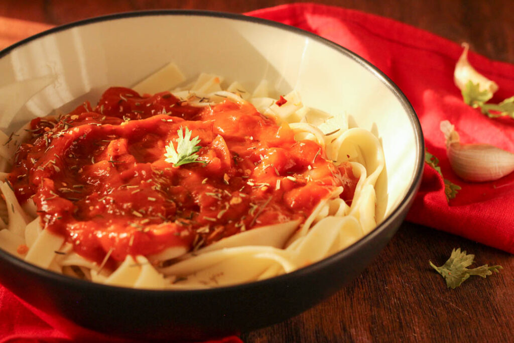 This recipe makes use of tomato paste, fresh tomatoes and Italian herbs to make a flavorful and versatile tomato sauce which is quick to prepare. Toss with pasta to make the perfect dinner.