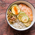 This post gives a detailed explanation of how to make brown rice and a recipe for an Asian style brown rice bowl with chicken and vegetables.