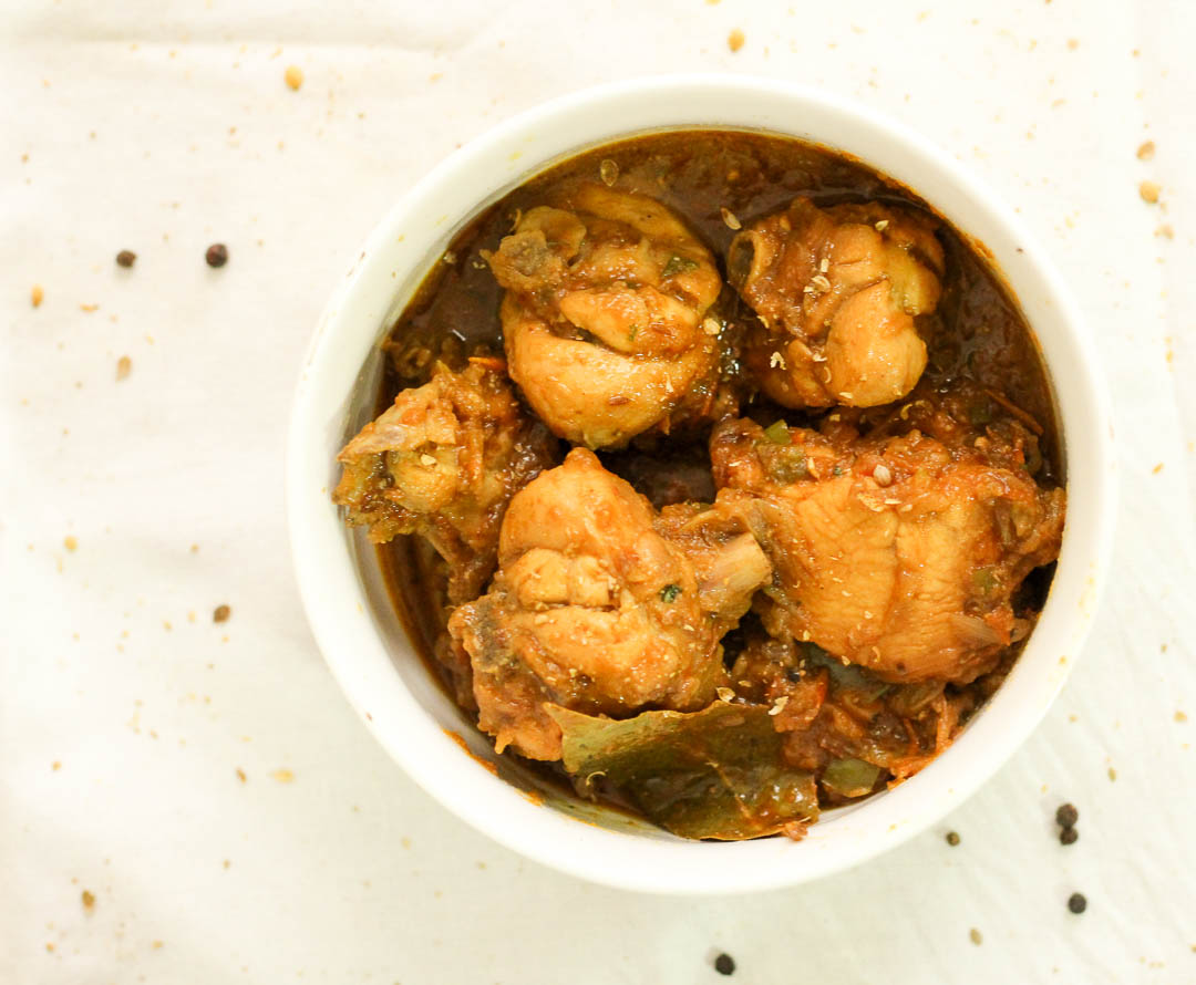 Chicken Curry or Murghi ka salan is a staple at the Pakistani dinner table. This particular version is made with a base of onions and tomatoes, and is best served with roti.