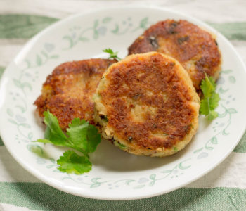 Aloo Kabab or Potato Cutlets is a versatile Pakistani vegetarian recipe made by frying a crispy patty of mashed potatoes and peas flavored with local herbs and spices.