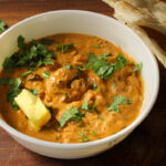 Butter Chicken or Chicken Makhani is a popular recipe at Indian restaurants made by marinating and grilling boneless chicken pieces, after which they are cooked in a rich tomato and cream based gravy.