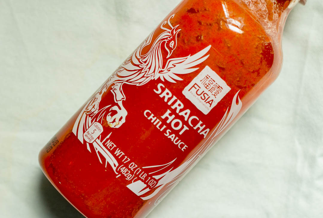 Ingredient Spotlight: Sriracha Sauce. This hot sauce originating from Vietnam adds heat and a hint of sweetness to daily meals. Also known as rooster sauce, it can be used as a dip, condiment, marinade and more!