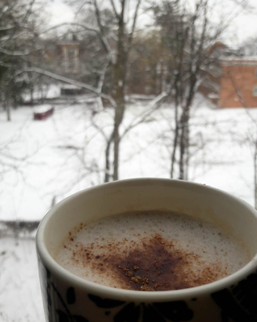 A cup of hot chocolate with snowfall. Monthly Favorites January 2018. A quick recap of my favorite recipes, travel stories, food reviews, books to read and purchases for this month.