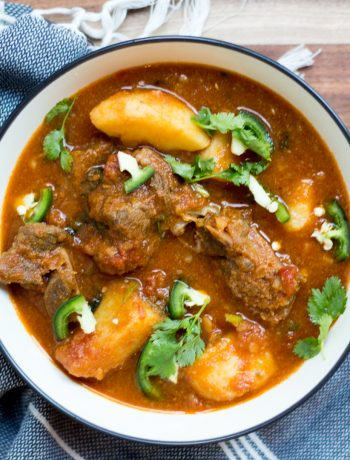 Aloo gosht or mutton curry with potatoes is a Pakistani meat curry made with meat (mutton or goat meat in this recipe) and potatoes in a curry base made of onion and tomatoes. Recipe includes stovetop method and pressure cooker method.