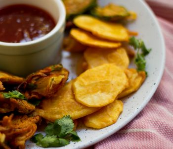 Similar to potato fritters, aloo pakora or aloo pakoda (in Hindi) are a traditional Pakistani / Indian appetizer of sliced potatoes that are coated with a spicy chickpea flour batter and deep-fried till golden brown.