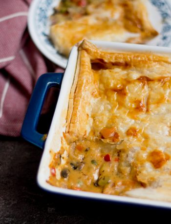 Chicken pot pie is comfort food personified. Chicken and vegetables in a rich and creamy white sauce with flaky puff pastry on top. Delicious!