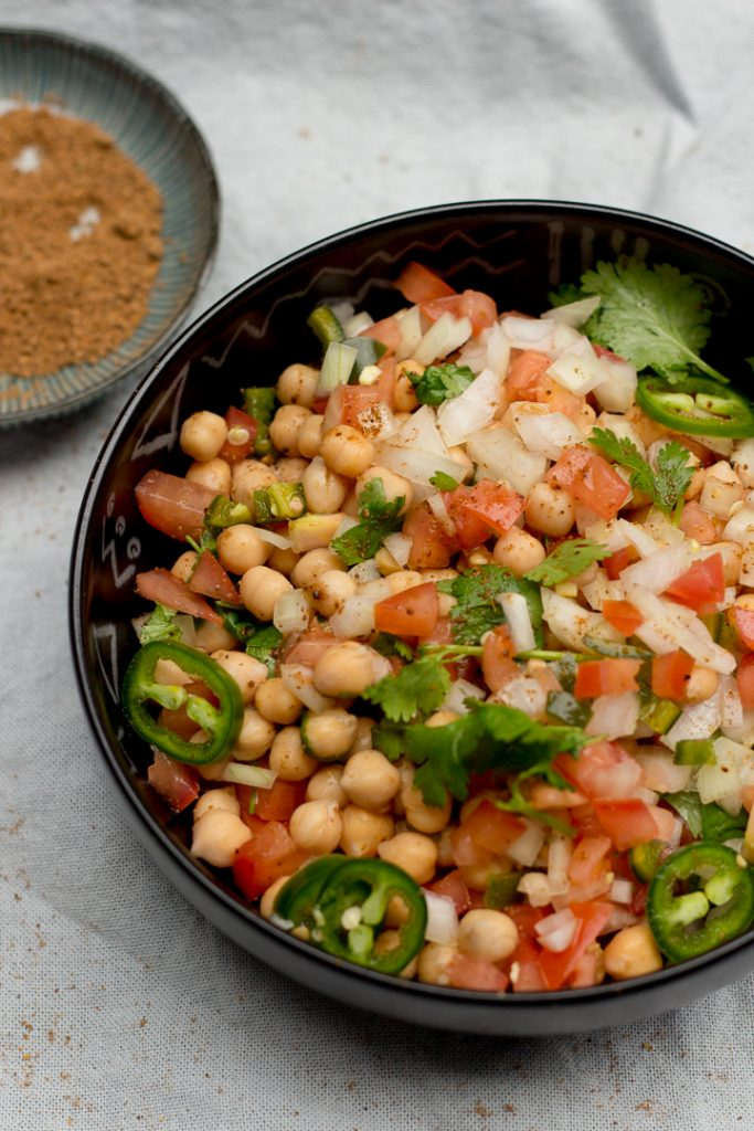 Chana chaat is the Desi version of a salad. The base is chickpeas or chana with onions, tomatoes, green chilies and coriander as the supporting characters finished off with chaat masala and lemon juice for that necessary spice and khataaz!