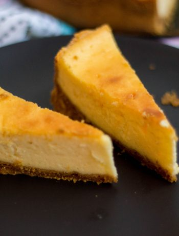 This classic baked cheesecake is super simple to make and makes a cheesecake that is smooth and creamy with a hint of lemon. Serve it plain or with fruits on side.
