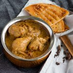 A recipe for traditional chicken korma made in the Pakistani or North Indian style with chicken, yoghurt, whole spices and lots of fried onions. Serve with sheermal for the authentic Mughlai touch.