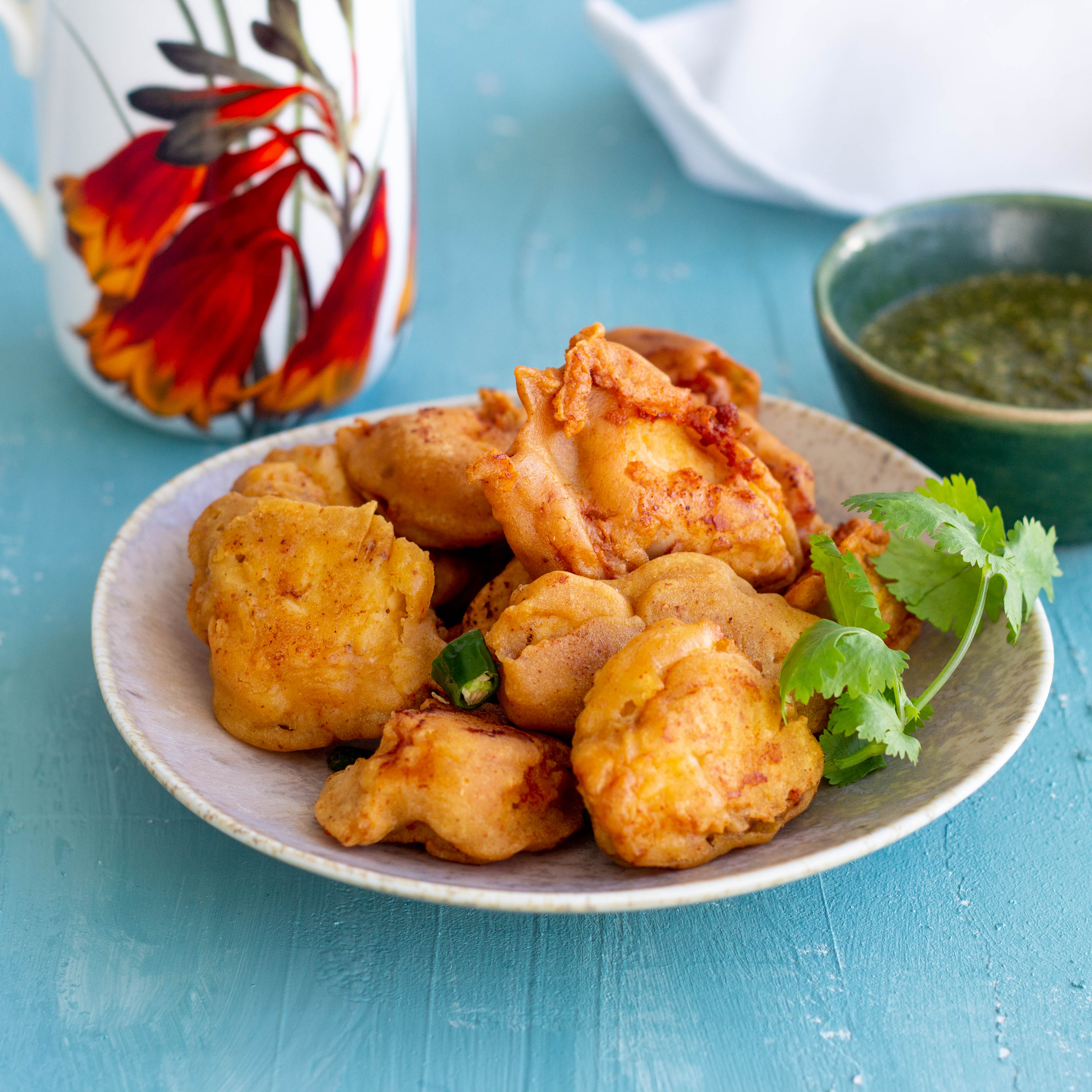 Chicken pakora are a super simple & delicious snack to make. Boneless chicken pieces are coated with a gram flour (besan) batter and fried till golden brown. Crispy & crunchy they will be a hit with adults and kids alike. Serve hot with green chutney or tomato ketchup with a cup of chai on the side.