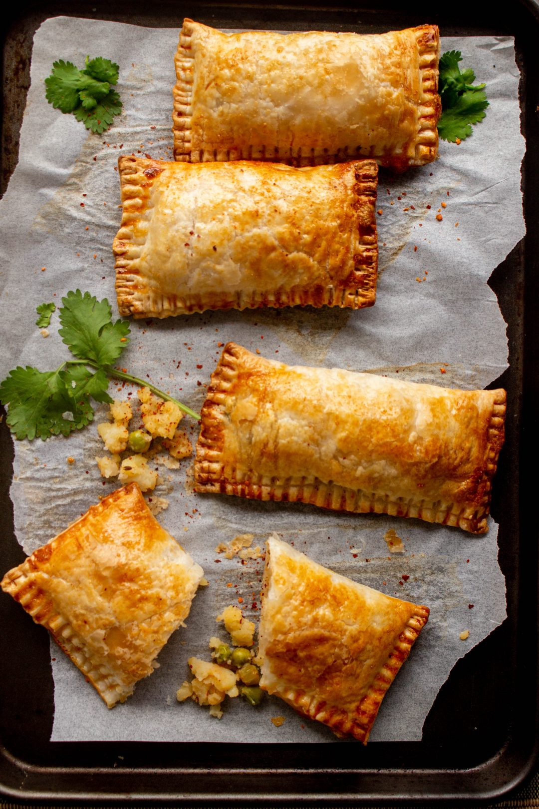 These Pakistani bakery style vegetable patties or vegetable puffs are a perfect tea time snack with a spicy potato and peas filling encased in crispy flaky puff pastry.