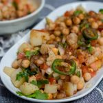 Aloo chana chaat is a Pakistani and Indian street food style snack made with potatoes and chickpeas. It's super simple to make and is a perfect blend of spice with tanginess!