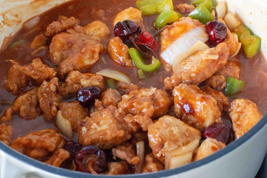 Chicken manchurian gravy in a dutch oven pot.