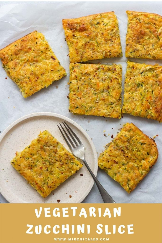 Six pieces of vegetarian zucchini slice on parchment paper. On the bottom right is a plate with a piece of zucchini slice, with a fork next to it.